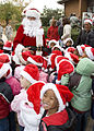 U.S. Army Col. Jackie J. Bryant plays Santa Claus for children attending a Christmas House event at Fort Gordon, Ga. 081128-A-NF756-004.jpg