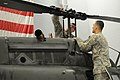 U.S. Army Spc. Jonathan E. Johnson, left, and Sgt. Robert I. Totu, both aircraft repairers with the 1st Battalion, 224th Aviation Regiment, Vermont Army National Guard, inspect the rotor of an OH-58 Kiowa 131103-Z-NB545-142.jpg