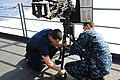 U.S. Navy Aviation Ordnanceman Airmen Richard Fredette, left, and Alexander Dammer perform maintenance on a gun mount aboard the aircraft carrier USS George H.W. Bush (CVN 77) April 24, 2013, in the Atlantic 130424-N-CZ979-145.jpg