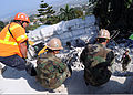 U.S. Navy Builder 2nd Class Thomas Camera, from Naval Mobile Construction Battalion (NMBC) 7, works with engineering teams March 12, 2010, to clear the rubble and rebar at the Hotel Montana in Port-au-Prince 100312-N-HX866-004.jpg
