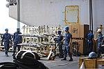 U.S. Sailors unload equipment from an aircraft elevator aboard the aircraft carrier USS Dwight D. Eisenhower (CVN 69) Aug. 22, 2013, at Naval Station Norfolk, Va 130822-N-MD211-035.jpg