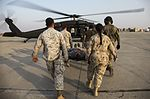 U.S. and Coalition medical personnel train through Mass Casualty Exercise 150821-M-TT095-123.jpg