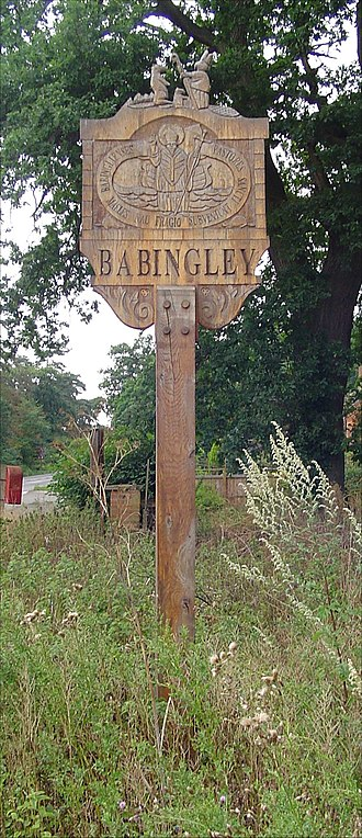 Babingley - Village sign showing the legend of St Felix and the beaver