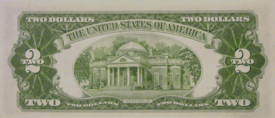 "Monticello depicted on the reverse of the 1953 $2 bill. Note the two ""Levy lions"" on either side of the entrance. The lions, placed there by Jefferson Levy, were removed in 1923 when the Thomas Jefferson Foundation purchased the house."
