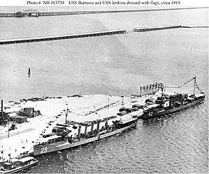 USS Burrows (DD-29) and USS Jenkins (DD-42) in port, dressed with flags, circa 1919.