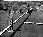 USS Kearsarge (CVA-33) under Golden Gate Bridge c1952.jpg