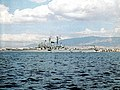 USS Newport News (CA-148) at anchor in 1958.jpg
