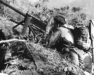 M1919 Browning machine gun - A US soldier takes aim with a tripod-mounted M1919A4 in Korea, 1953
