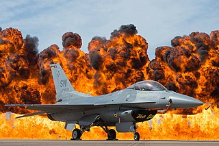 An F-16 Viper parked in front of a wall of fire at the 2017 Fort Worth Airshow
