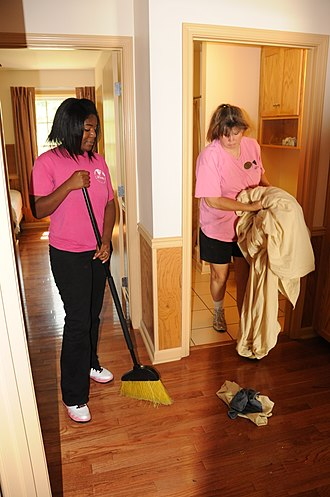 Housekeeping - Two women cleaning the floor