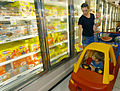 US Navy 020813-N-3235P-527 A mother shops for groceries with her son and daughter in the freezer section of the Navy Commissary located just outside Naval Air Station Oceana.jpg