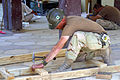 US Navy 030506-M-5882G-016 Builder 1st Class Billy Cloke, assists with repairs to a local school.jpg