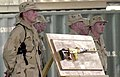 US Navy 030826-N-9455K-023 Seabees stand watch over a gold plated Dragunov sniper rifle once owned by Uday Hussein at Camp Moreell, Kuwait.jpg
