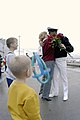 US Navy 030919-N-6477M-157 Senior Chief Boatswain's Mate James Williams assigned to the USS Ingraham (FFG 61) is welcomed home by his wife and sons upon returning from deployment.jpg
