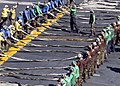 US Navy 041118-N-5837R-111 Crew members aboard the Nimitz-class aircraft carrier USS Abraham Lincoln (CVN 72) stretch out the emergency-landing barricade during a flight deck drill.jpg
