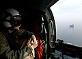 US Navy 050204-N-5345W-003 An Aviation Warfare Systems Operator watches from his door-gunner position aboard an SH-60 Seahawk as the Nimitz-class aircraft carrier USS Harry S. Truman (CVN 75) steams through the open waters of.jpg
