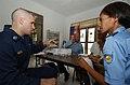 US Navy 050329-N-6665R-069 Lt. Robert Senko, an optometrist assigned to the Military Sealift Command (MSC) hospital ship USNS Mercy (T-AH 19), talks with a patient.jpg