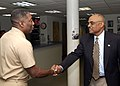 US Navy 050331-N-2510L-001 Assistant Secretary of the Navy, BJ Penn shakes the hand of Naval Air Station Oceana Command Master Chief Wayne R. Prescod, during a tour on board Naval Air Station Oceana, Va.jpg