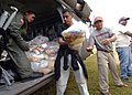 US Navy 051015-N-5526M-015 U.S. Army Sgt. David Villonurva, along with volunteers from Guatemala, load food and medical supplies onto a U.S. Army UH-60 Blackhawk helicopter.jpg