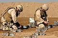 US Navy 060105-A-3283V-012 U.S. Navy Lt. Robert Marsh and Boatswain's Mate 1st Class Bill Davison prepare for a test detonation at a range in Ad Diwaniyah, Iraq.jpg