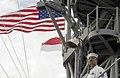 US Navy 060529-N-9851B-005 Personnel Specialist 1st Class Aldwin Camuro mans the rails aboard the amphibious dock landing ship USS Tortuga (LSD 46) as she pulls into Changi Naval Base, Singapore.jpg