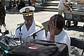 US Navy 060617-N-3271W-001 Reserve Deputy Commander, Commander Navy Installations, Rear Adm. Julius Caesar, conducts a radio interview with KPOO-89.5 FM radio during festivities at the annual Juneteenth Festival.jpg