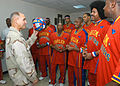 US Navy 061208-N-1328C-253 Combined Joint Task Force-Horn of Africa Commander, Rear Adm. Richard Hunt, meets with the Harlem Globetrotters, prior to their performance at Camp Lemonier, home of the Combined Joint Task Force-Horn.jpg