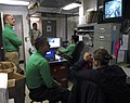 US Navy 070204-N-3659B-078 Sailors assigned to Airborne Early Warning Squadron One One Three (VAW-133) watch Super Bowl XLI in their work center aboard Nimitz-class aircraft carrier USS Ronald Reagan (CVN 76).jpg