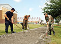 US Navy 070426-N-7427G-001 Seabees assigned to the Public Works department install a new sidewalk outside of the Naval Operational Support Center on Naval Air Station Joint Reserve Base New Orleans.jpg