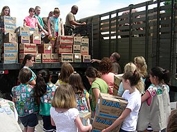 US Navy 070609-N-6897L-018 Navy Cargo Handling Battalion 8 assists hundreds of Girl Scouts from Westchester and Putnam counties in New York load more than 33,000 boxes of cookies as part of Operation Cookie Drop
