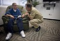 US Navy 070718-N-0696M-305 Chief of Naval Operations (CNO) Adm. Mike Mullen speaks with Lance Cpl. Brandon Mendez, from Santa Ana, Calif., during a visit to Naval Medical Hospital Balboa.jpg