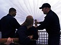 US Navy 070718-N-4163T-106 Sailors stationed aboard dock landing ship USS Germantown (LSD 42) teach midshipmen the proper way to handle a fire hose.jpg