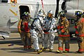 US Navy 070724-N-0924R-153 Firemen from Navy Mid-Atlantic Region Fire and Rescue Team help Sailors posing as victims escape a simulated C-2A Greyhound plane crash during a crash, fire and rescue drill held on Naval Station Norf.jpg
