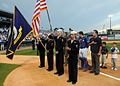 US Navy 090424-N-9824T-094 ailors assigned to Navy Operational Support Center Des Moines parade the colors during the National Anthem at an Iowa Cubs Minor League baseball game during Des Moines Navy Week.jpg