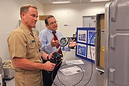 US Navy 090929-N-8863V-016 Rear Adm. Kevin Quinn, commander, Naval Surface Force Atlantic, left, operates a portable pressure calibrator as Quality Manager Jeff Walden explains its use