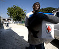 US Navy 100125-N-6266K-163 A Haitian earthquake survivor leaves a local Red Cross distribution site after receiving non-perishable items in Port-au-Prince.jpg