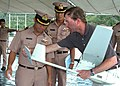 US Navy 100516-N-3446M-024 Paul Trist Jr., right, a civilian flight demonstration manager, shows Royal Thai Navy officers how to install the tail rudder on the Puma AE mini-unmanned aerial vehicle.jpg