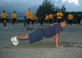 US Navy 100820-N-5216W-009 Chief Gas Turbine Systems (Electrical) Warren Zosa, assigned to the submarine tender USS Frank Cable (AS 40), demonstrates the proper form for push-ups to chief petty officer selects.jpg