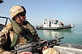 US Navy 101004-N-0413B-113 British Royal Marine, assigned to coalition security forces at Umm Qasr camp, provides security for Iraqi sailors and U.jpg