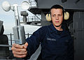 US Navy 101203-N-6863R-039 Aerographer's Mate Airman Joshua Chalmers measures wind speed with a hand-held anemometer aboard the aircraft carrier US.jpg