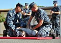 US Navy 101207-N-7764M-323 Master-at-Arms 3rd Class Jason Rodriguez and Master-at-Arms 3rd Class Daniel Watson practice handcuffing a suspect.jpg