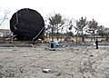 US Navy 110314-N-MU720-071 A Sailor assigned to Naval Air Facility Misawa picks up debris during a cleanup effort at the Misawa Fishing Port.jpg