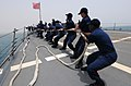 US Navy 110626-N-TB177-311 Sailors aboard the guided-missile destroyer USS Truxtun (DDG 103) heave a line as the ship pulls into port in Djibouti.jpg