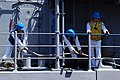 US Navy 110725-N-OB313-154 Line handlers secure mooring lines aboard USS Champion (MCM 4) as it pulls into Los Angeles Harbor.jpg