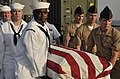 US Navy 110822-N-AG285-281 Sailors and Marines carry a casket during a burial at sea ceremony for three U.S. Navy veterans aboard the amphibious do.jpg