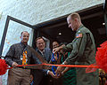 US Navy 111005-N-UD469-004 Capt. Yancy B. Lindsey, commander of Naval Base Coronado, cuts the ribbon at the opening ceremony of Starbucks.jpg