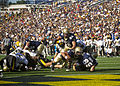 US Navy 111008-N-AC887-003 U.S. Naval Academy quarterback Kriss Proctor (^2) dives for the goal line during an NCAA football game.jpg