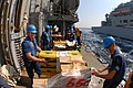 US Navy 111018-N-DU438-350 Sailors unwrap pallets of stores aboard the guided-missile cruiser USS Gettysburg (CG 64) during a connected replenishme.jpg