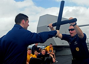 US Navy 111231-N-ZF681-127 Sailors practice crowd control tactics during combat training aboard the guided-missile destroyer USS Halsey (DDG 97).jpg