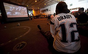 US Navy 120206-N-OY799-136 Aviation Boatswain's Mate (Equipment) Airman Charmeta Coble watches her team play during the Super Bowl party in the han.jpg